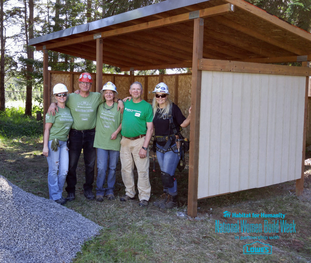 Construction Project Manager Paul Stromdahl (dark green shirt) with volunteers from North Sound Carpenters Union, Local #70