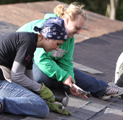 Habitat volunteers roofing.