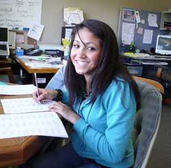 A Habitat volunteer works in the officee