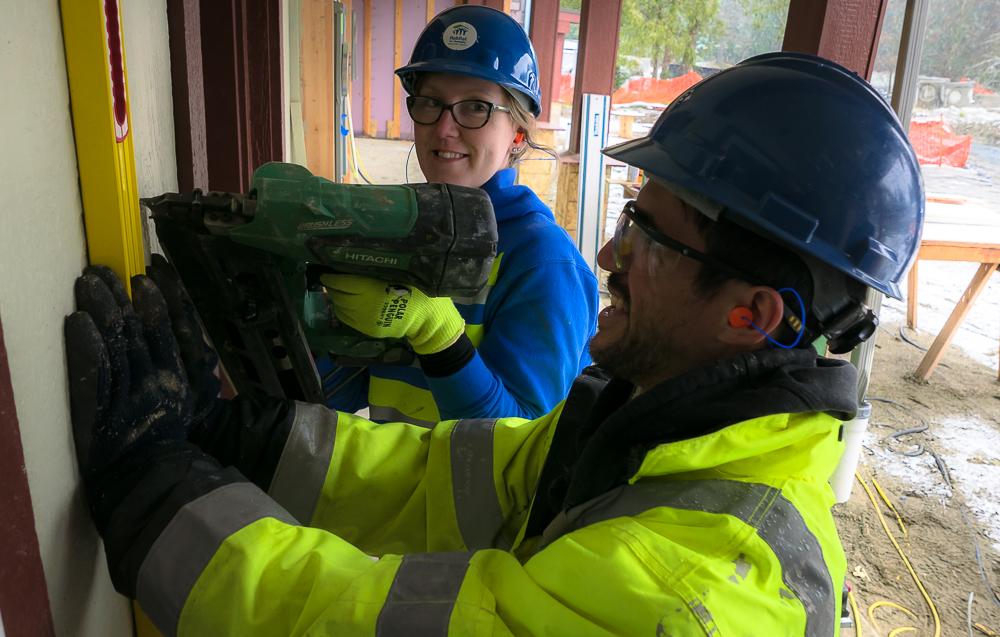 Edie Stickel working on siding at Telegraph